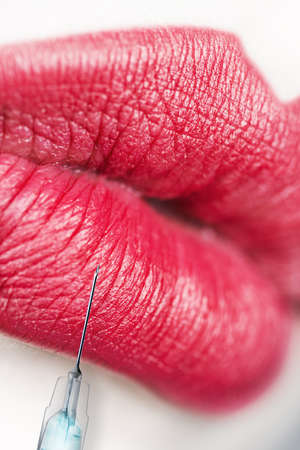 Lips injection. Beauty concept. photo