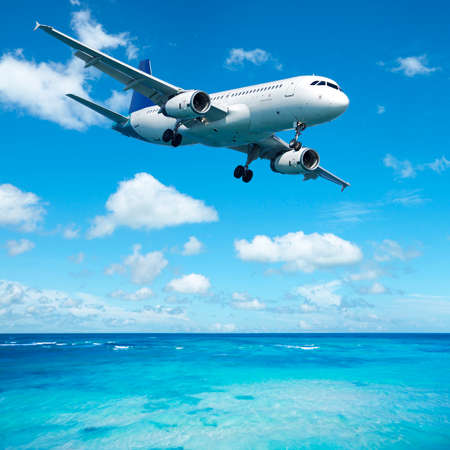 over the sea: Jet plane over the tropical sea