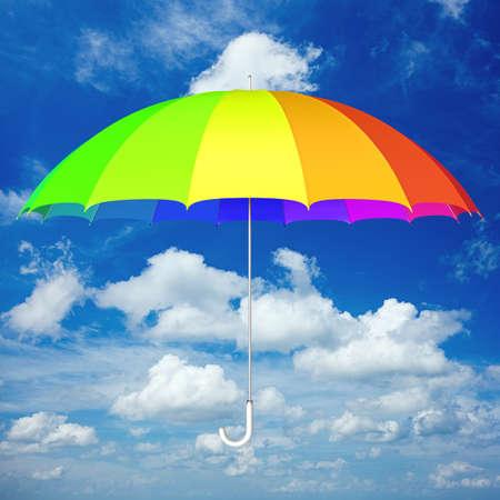 Colorful umbrella against blue cloudy sky 3D illustration