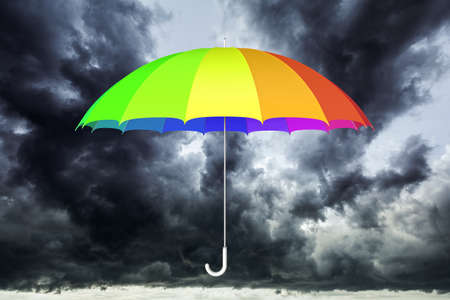 Colorful umbrella against dark cloudy sky 3D illustration