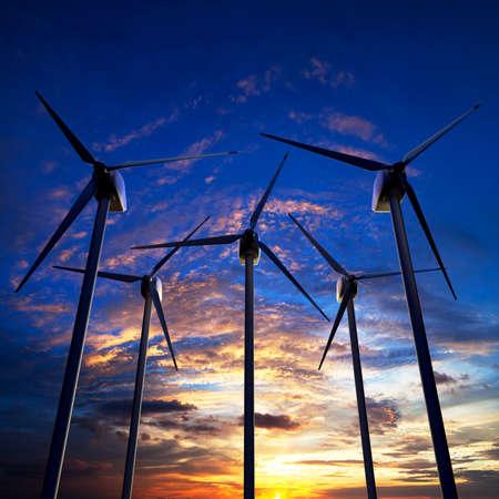 Wind farm against sunset sky 3D illustration Stockfoto