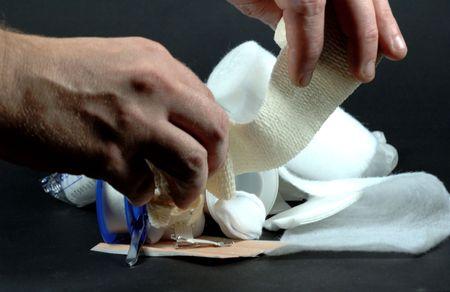 cut wrist: bandaging Stock Photo