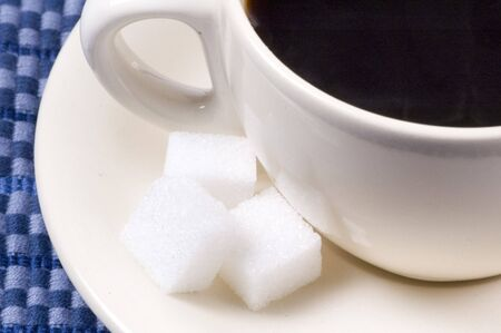 suger: coffee with suger on table cloth Stock Photo