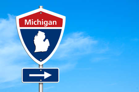 Road trip to Michigan, Red, white and blue interstate highway road sign with word Michigan and map of Michiganwith sky background