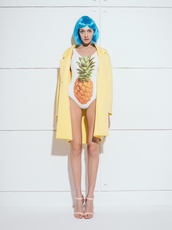 editorial: blue hair, hairstyle, long legs, model, high heels, shoot studio fashion editorial suit clothes yellow pineapple