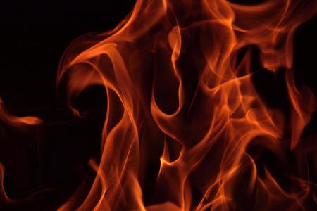 fire brick: Fire flames in a brick fireplace.