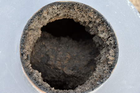 creosote: Chimney flue covered with a thick layer of carbon black heat exchanger