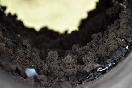 creosote: Chimney flue pipe covered with a thick layer of soot.