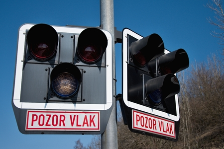 Unprotected railway crossing. Railway signaling equipment at a train crossing, Czech Republic. Railway infrastructure. Sunny weather Imagens