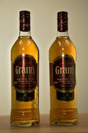 Svitavy, Czech Republic - Two bottles of Scotch Grants whiskey on the table. Whiskey alcoholic drink