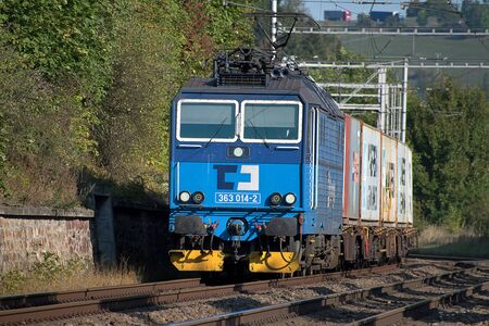 Svitavy, Czech Republic - 20.4.2019: Freight train with container wagons, CD Cargo. Loaded containers on wagons