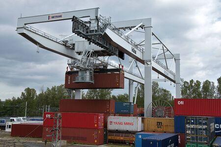 Ceska Trebova, Czech Republic - 20.4.2019: Container train terminal company METRANS. Cranes for loading containers. Railway junction and railway station Ceska Trebova