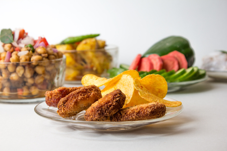 Chicken Nuggets with chips and Chana Chaat, Chola Chaat, Ramadan iftar plate Stock Photo