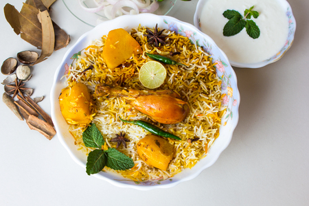 Pakistani biryani, Traditional indian food, Spicy chicken rice with potato on white background. Banco de Imagens