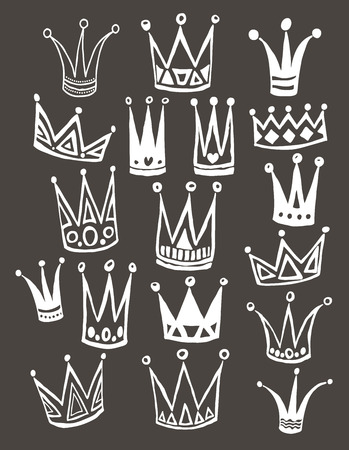 Set of cute cartoon crowns. Hand drawing vector background.  Vector illustration. Vettoriali