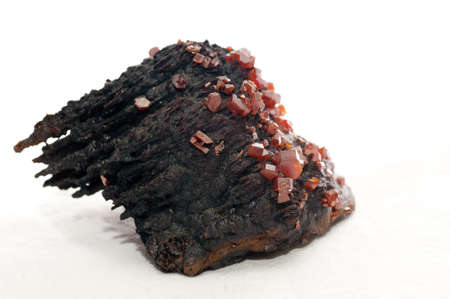 red vanadinite crystal mineral sample on metamorphic rock Stock Photo