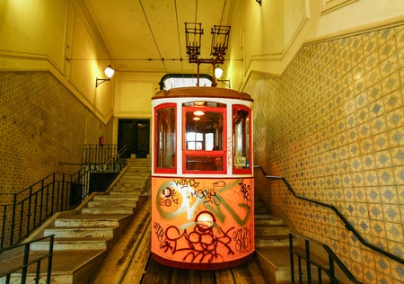LISBON, PORTUGAL - OCTOBER 23,2012 : Lisbons Gloria funicular classified as a national monument opened 1885 located on the west side of the Avenida da Liberdade connects downtown with Bairro Alto.