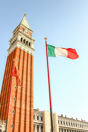 Italy and Venice flag at San Marco square, Venice, Italy