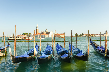 saint mark square: Gondolas moored by Saint Mark square with San Giorgio di Maggiore church in the background, Venice, Italy