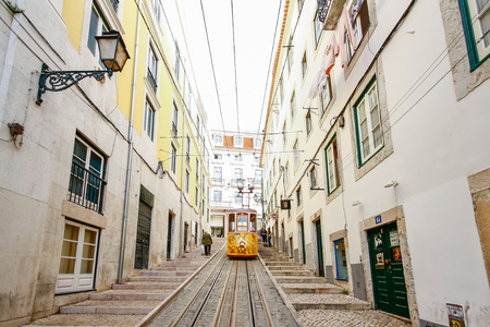 gloria: LISBON, PORTUGAL - OCTOBER 23,2012 : Lisbons Gloria funicular classified as a national monument opened 1885 located on the west side of the Avenida da Liberdade connects downtown with Bairro Alto.