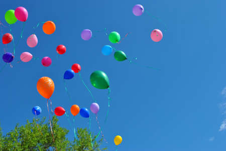 Colorful balloons on blue sky background. Holiday.