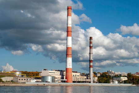Industrial zone on the river. Chimney.