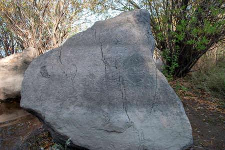 Sikachi-Alyan. Petroglyphs on the rocks Stock Photo