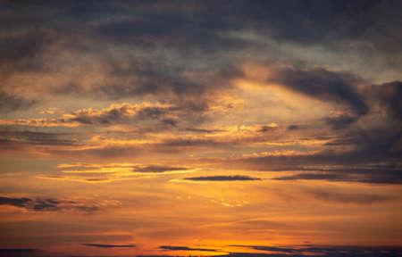 Landscape. Sunlit cloudy sky. Sunset