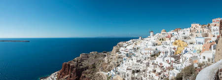 Panoramic View With Iconic Windmills Of Santorini