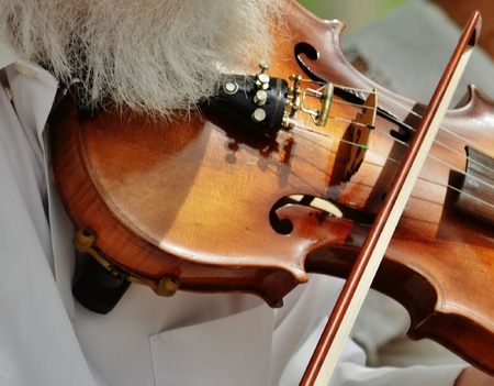 bluegrass: An accomplished musician playing the fiddle.