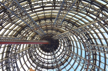 girders: Steel girders and beams inside a conical shaped building. Stock Photo
