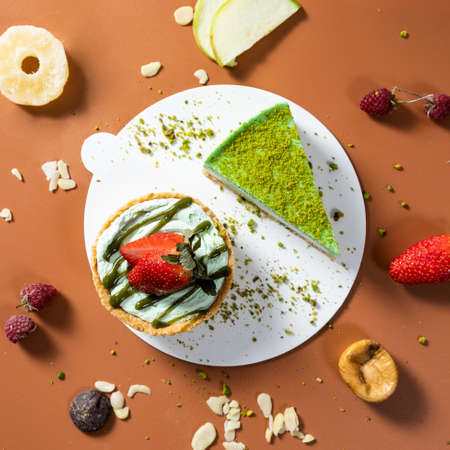 Tasty colorful chocolate cakes with fruits, top view