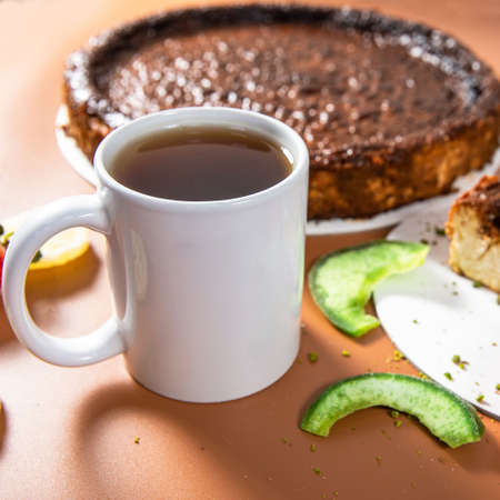 Tasty colorful chocolate cake with tea cup close up
