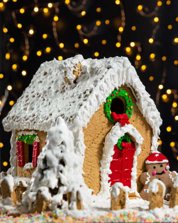 Christmas, new year house shape cake with bokeh, lights
