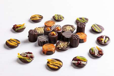 Chocolate pieces on the white background, top view