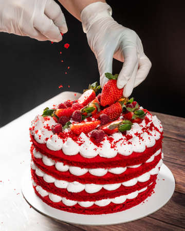 Tasty red strawberry chocolate cake, pouring ingredient