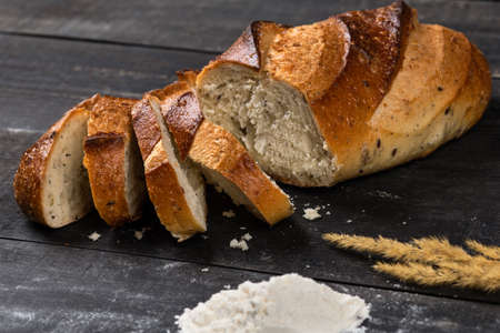Tasty bread slices with flour and cereal plant