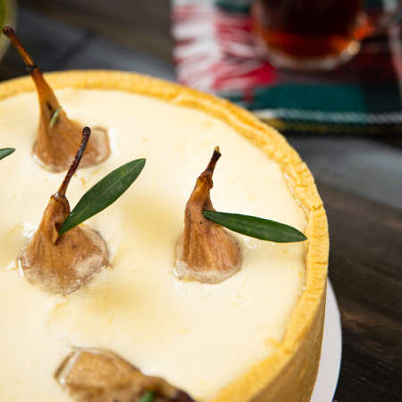 Different beautiful pear cake on the wooden table 스톡 콘텐츠