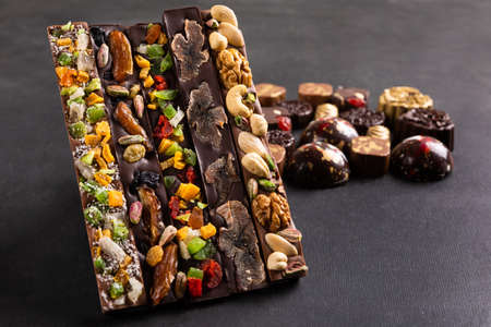 Luxury chocolate pieces on the black background