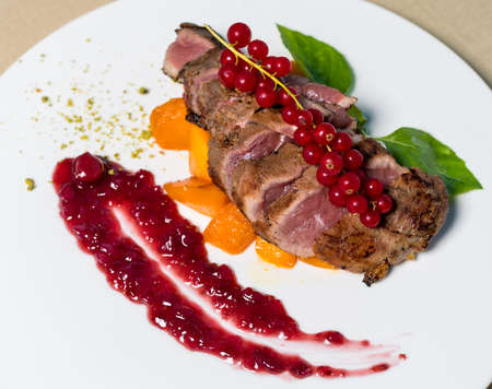 Cooked Steak with Lingonberry on it