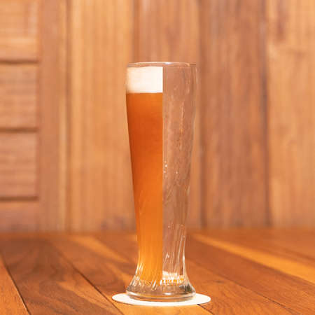 Creative half empty beer drink mug, glass on the table