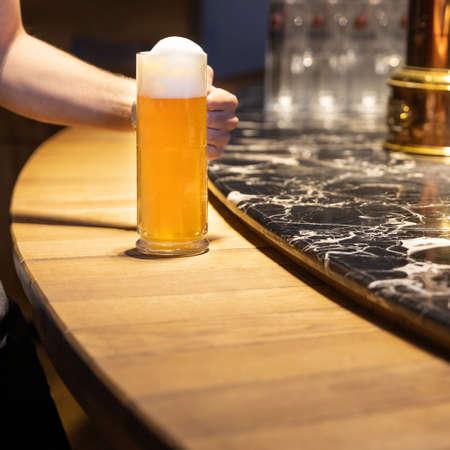 Man holding beer mug, glass