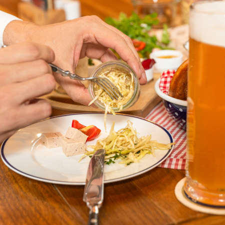 Eating fringed cheese with beer