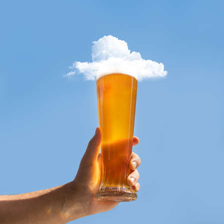Man holding beer glass with cloud on it