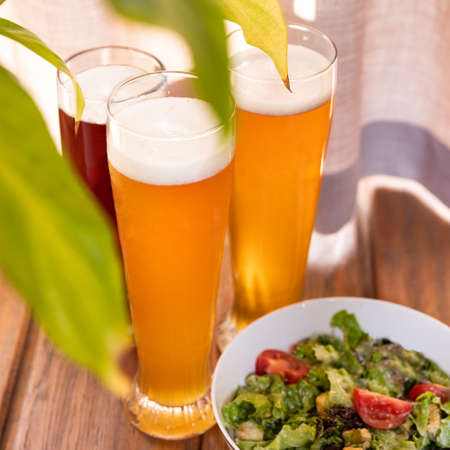 Beer glasses with salad close up 스톡 콘텐츠