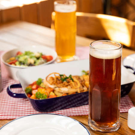 Dark and white beer glasses with dish