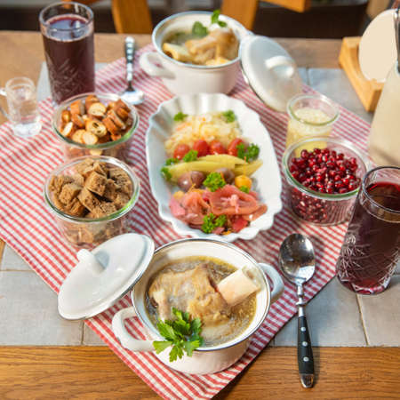 Pomegranate juice with vodka meat meals and snacks, top view 스톡 콘텐츠
