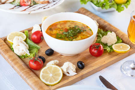 Tasty pasta soup with vegetables