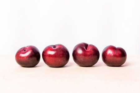 Red plum fruits on the white background isolated 免版税图像 - 156240292