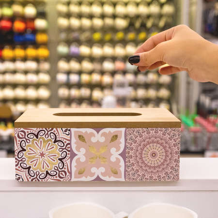 Decorated wood napkin box close up 免版税图像 - 156103557